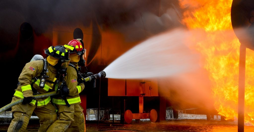 Business Safety Week : Firefighters putting out fire